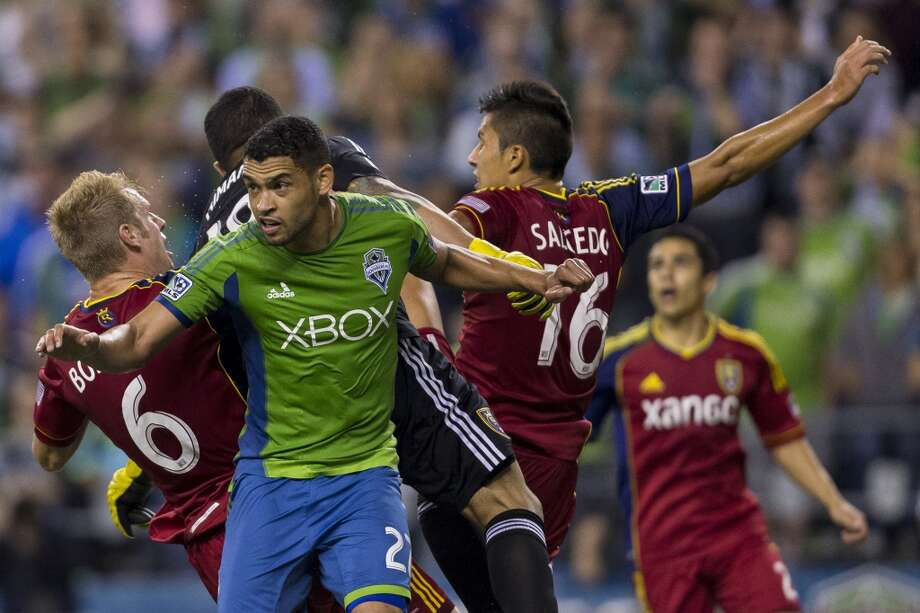 Players and goalkeeper Lalo Fernandez, in black, collide during the first half of a game Friday, September 13, 2013, at CenturyLink Field in Seattle. The Sounders led Real Salt Lake 2-0 at the half. With over 52,000 tickets distributed, the Sounders put their 12-game home unbeaten streak on the line during the face-off with Real Salt Lake. (Jordan Stead, seattlepi.com) Photo: JORDAN STEAD, SEATTLEPI.COM