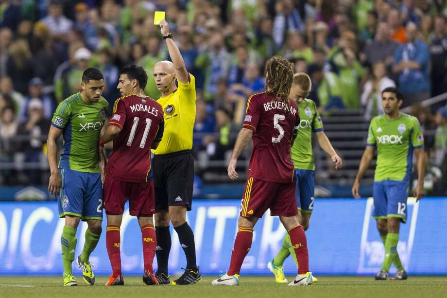 A referee interferes with players during the first half of a game Friday, September 13, 2013, at CenturyLink Field in Seattle. The Sounders led Real Salt Lake 2-0 at the half. With over 52,000 tickets distributed, the Sounders put their 12-game home unbeaten streak on the line during the face-off with Real Salt Lake. (Jordan Stead, seattlepi.com) Photo: JORDAN STEAD, SEATTLEPI.COM