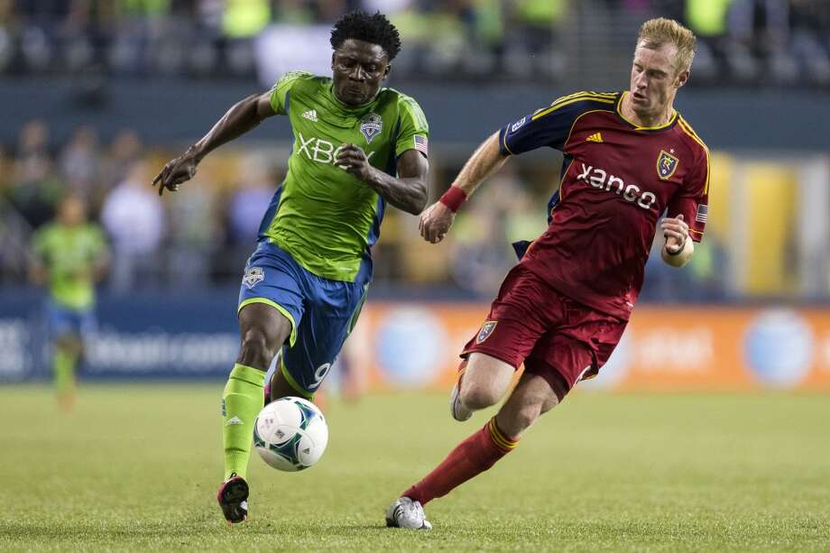Obafemi Martins, left, dribbles past Real Salt Lake defense during the first half of a game Friday, September 13, 2013, at CenturyLink Field in Seattle. The Sounders led Real Salt Lake 2-0 at the half. With over 52,000 tickets distributed, the Sounders put their 12-game home unbeaten streak on the line during the face-off with Real Salt Lake. (Jordan Stead, seattlepi.com) Photo: JORDAN STEAD, SEATTLEPI.COM