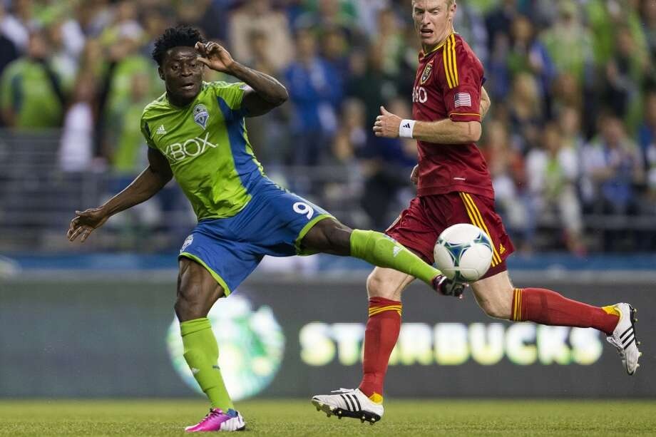 Obafemi Martins, left, attempts to dribble past Real Salt Lake defense during the second half of a game Friday, September 13, 2013, at CenturyLink Field in Seattle. The Sounders led Real Salt Lake 2-0 at the half. With over 52,000 tickets distributed, the Sounders put their 12-game home unbeaten streak on the line during the face-off with Real Salt Lake. (Jordan Stead, seattlepi.com) Photo: JORDAN STEAD, SEATTLEPI.COM