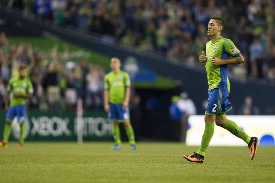 Clint Dempsey, right, is played during the second half of a game Friday, September 13, 2013, at CenturyLink Field in Seattle. The Sounders beat Real Salt Lake 2-0. With over 52,000 tickets distributed, the Sounders put their 12-game home unbeaten streak on the line during the face-off with Real Salt Lake. (Jordan Stead, seattlepi.com) Photo: JORDAN STEAD, SEATTLEPI.COM