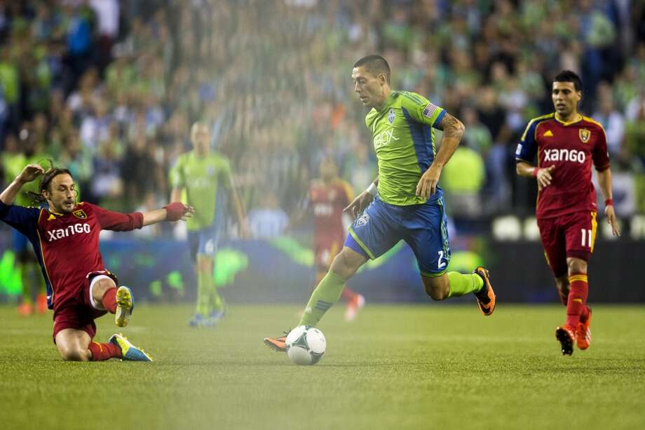 Clint Dempsey, center, pushes through Real Salt Lake defense toward the goal during the second half of a game Friday, September 13, 2013, at CenturyLink Field in Seattle. The Sounders beat Real Salt Lake 2-0. With over 52,000 tickets distributed, the Sounders put their 12-game home unbeaten streak on the line during the face-off with Real Salt Lake. (Jordan Stead, seattlepi.com) Photo: JORDAN STEAD, SEATTLEPI.COM