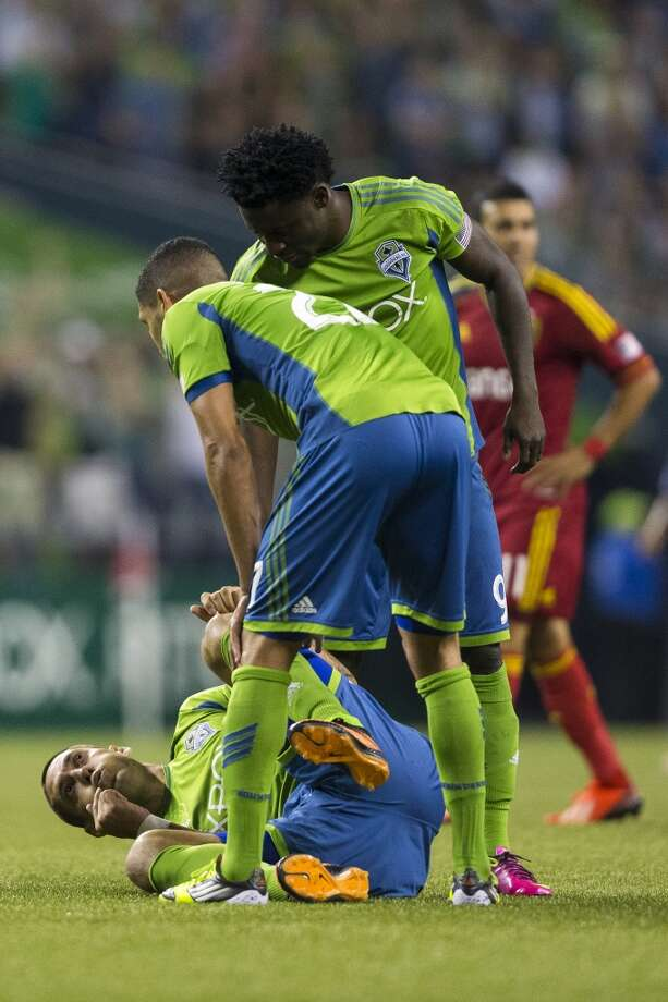 Clint Dempsey, left, reacts to falling while attempting to push through Real Salt Lake defense during the second half of a game Friday, September 13, 2013, at CenturyLink Field in Seattle. The Sounders beat Real Salt Lake 2-0. With over 52,000 tickets distributed, the Sounders put their 12-game home unbeaten streak on the line during the face-off with Real Salt Lake. (Jordan Stead, seattlepi.com) Photo: JORDAN STEAD, SEATTLEPI.COM