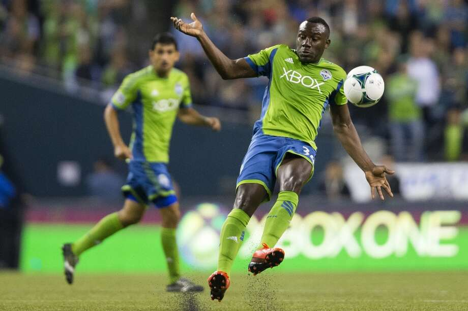 Jhon Kennedy Hurtado, right, slips while dribbling during the second half of a game Friday, September 13, 2013, at CenturyLink Field in Seattle. The Sounders beat Real Salt Lake 2-0. With over 52,000 tickets distributed, the Sounders put their 12-game home unbeaten streak on the line during the face-off with Real Salt Lake. (Jordan Stead, seattlepi.com) Photo: JORDAN STEAD, SEATTLEPI.COM