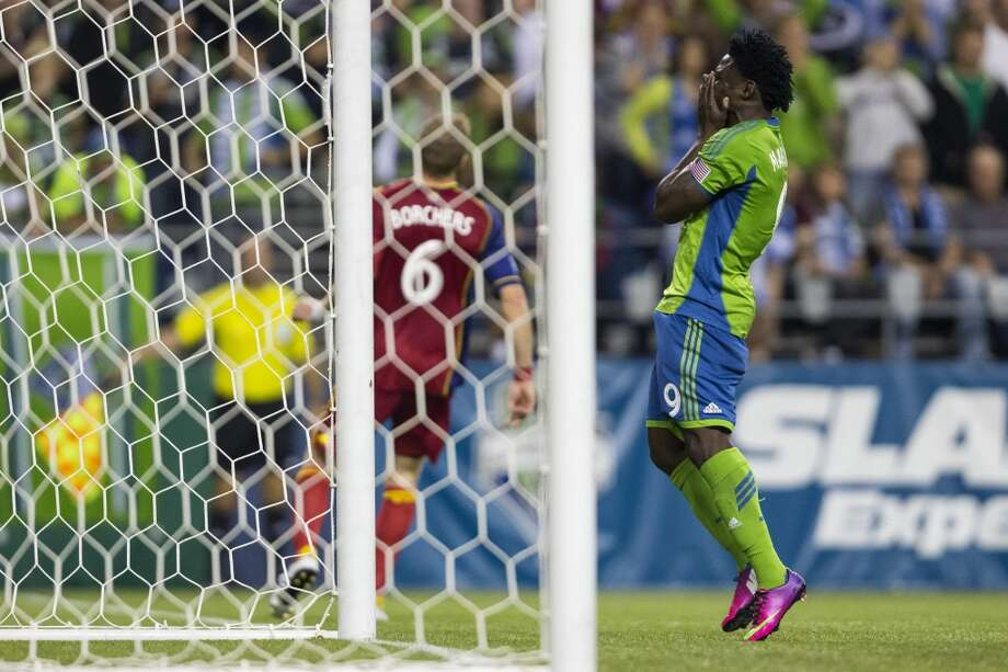 Seattle Sounder forward Obafemi Martins reacts to missing a shot on Real Salt Lake's goal during the second half of a game Friday, September 13, 2013, at CenturyLink Field in Seattle. With over 52,000 tickets distributed, the Sounders put their 12-game home unbeaten streak on the line during the face-off with Real Salt Lake. The Sounders won 2-0. (Jordan Stead, seattlepi.com) Photo: JORDAN STEAD, SEATTLEPI.COM