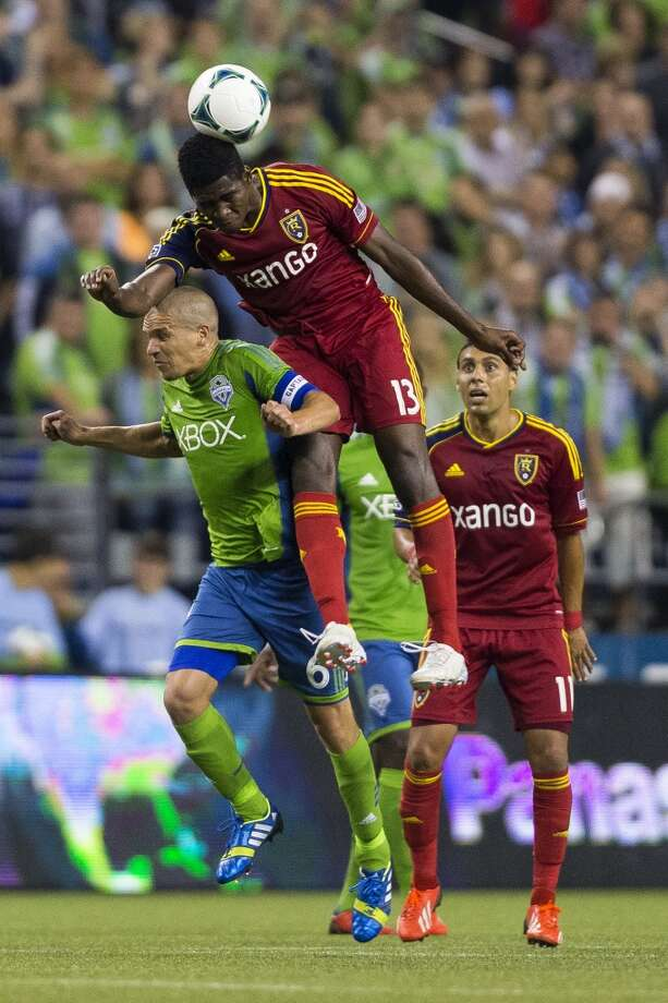 Olmes Garcia, center, of Real Salt Lake, collides with Osvaldo Alonso, left, during the second half of a game Friday, September 13, 2013, at CenturyLink Field in Seattle. The Sounders beat Real Salt Lake 2-0. With over 52,000 tickets distributed, the Sounders put their 12-game home unbeaten streak on the line during the face-off with Real Salt Lake. (Jordan Stead, seattlepi.com) Photo: JORDAN STEAD, SEATTLEPI.COM