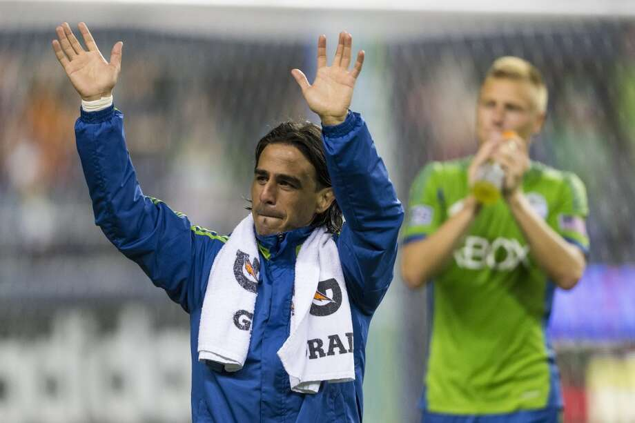 Mauro Rosales, left, waves to fans while leaving the field after beating Real Salt Lake 2-0 following the second half of a game Friday, September 13, 2013, at CenturyLink Field in Seattle. With over 52,000 tickets distributed, the Sounders put their 12-game home unbeaten streak on the line during the face-off with Real Salt Lake. (Jordan Stead, seattlepi.com) Photo: JORDAN STEAD, SEATTLEPI.COM