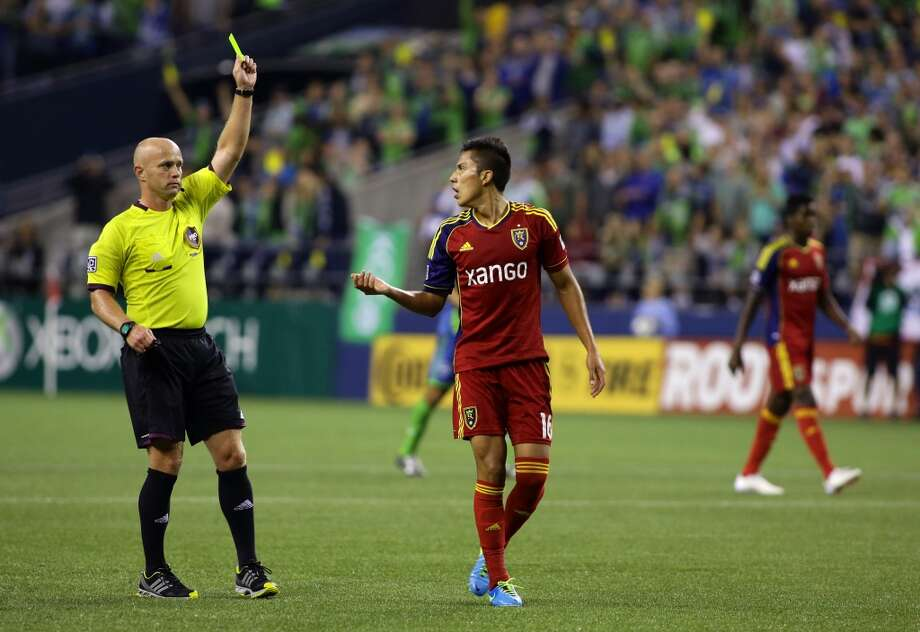 Real Salt Lake defender, Carlos Salcedo, gets a yellow card during the second half of a game Friday, September 13, 2013, at CenturyLink Field in Seattle. With over 52,000 tickets distributed, the Sounders put their 12-game home unbeaten streak on the line during the face-off with Real Salt Lake. The Sounders won 2-0. (Sy Bean, seattlepi.com) Photo: SEATTLEPI.COM