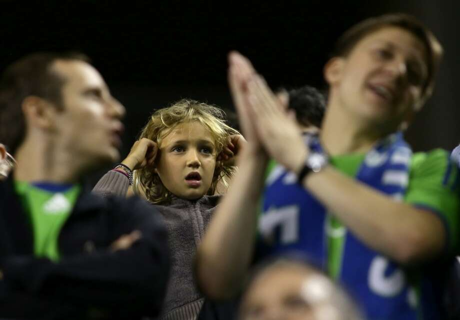A young fan covers her ears during the second half of a game Friday, September 13, 2013, at CenturyLink Field in Seattle. With over 52,000 tickets distributed, the Sounders put their 12-game home unbeaten streak on the line during the face-off with Real Salt Lake. The Sounders won 2-0. (Sy Bean, seattlepi.com) Photo: SEATTLEPI.COM