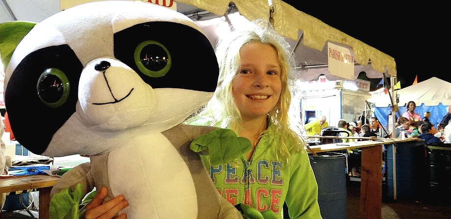 Lucy Cullinan, 9, of Fairfield, with a stuffed panda she won at a games booth at Septemberfest on Friday evening at Assumption parish. Photo: Mike Lauterborn / Fairfield Citizen contributed