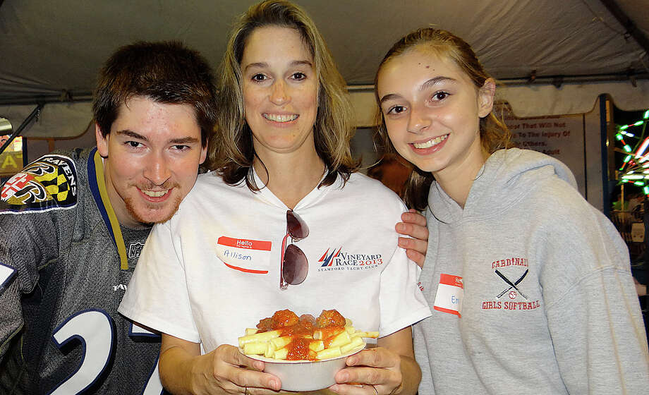 Sean, Allison and Emily Schofield serving ziti and meatballs to attendees of the opening night Friday of SeptemberFest at Assumption Church. Photo: Mike Lauterborn / Fairfield Citizen contributed