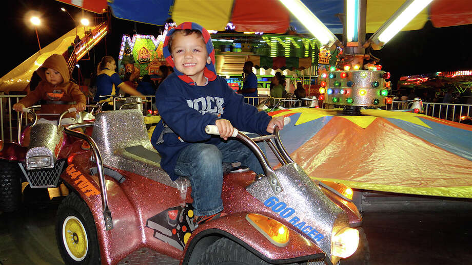Christopher Pruett, 4, on the Quads ride Friday at SeptemberFest. Photo: Mike Lauterborn / Fairfield Citizen contributed