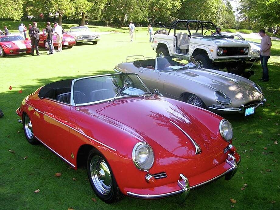 From front to rear: a 1960 Porsche 1600 Super roadster, owned by Jody Morrison; a 1963 Jaguar XK-E owned by Lynne Edminster and what looks like a Ford Bronco. Car in upper left of photo appears to be a Ford GT40.