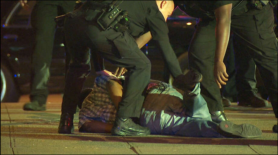 The suspect is taken into custody by police at the scene. Photo: KOMO