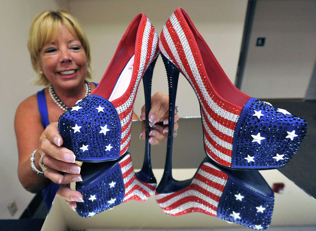 Miss America volunteer Fran McManus, looks at the shoes Miss Pennsylvania Annie Rosellini's will wear in the 2014 Miss America pageant's
