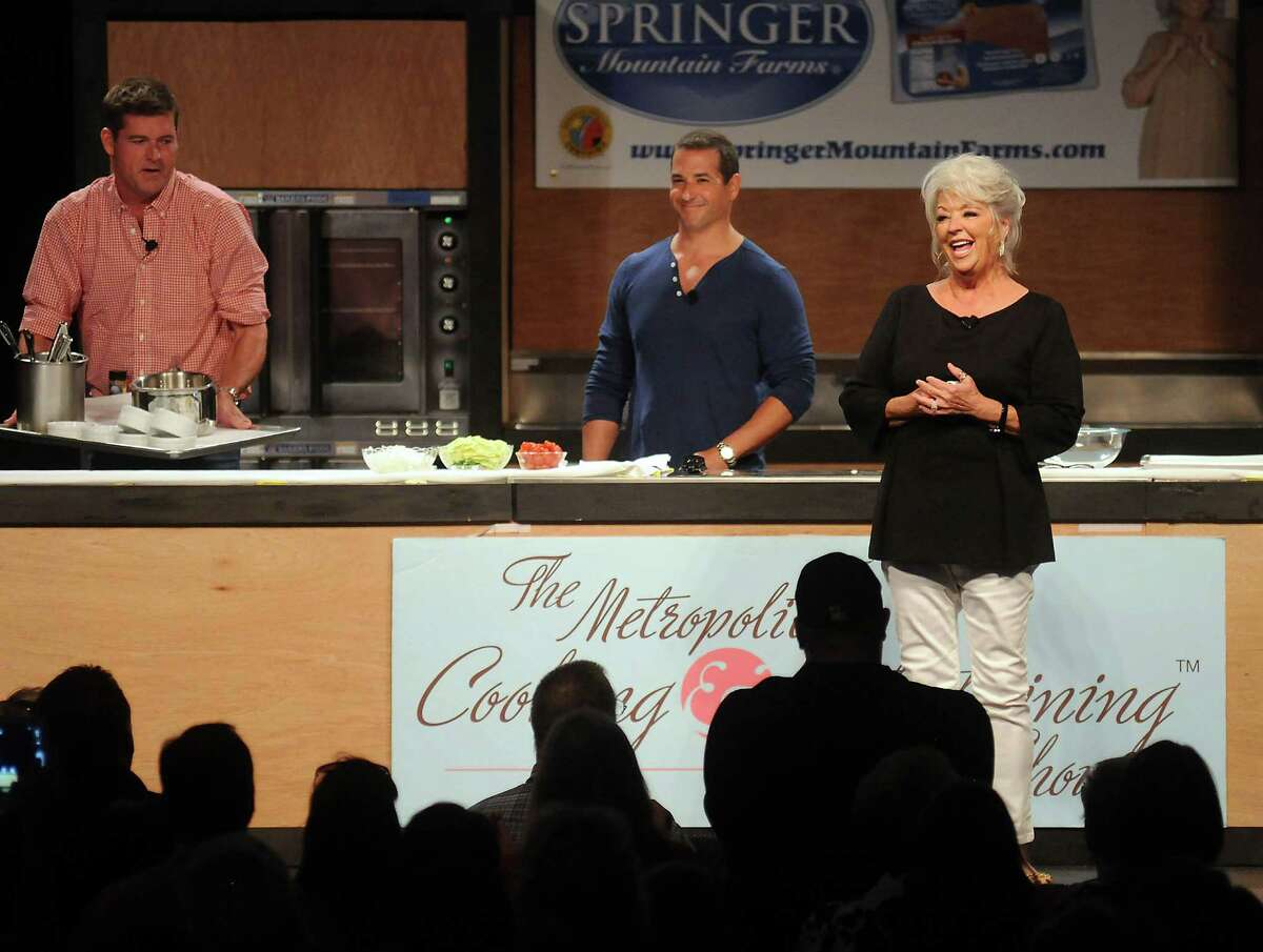Chef Paula Deen thanks the crowd for their support at the Metropolitan Cooking & Entertaining Show at the Reliant Center Saturday Sept. 14 2013. Also pictured are Deen's sons Jamie and Bobby.(Dave Rossman photo)