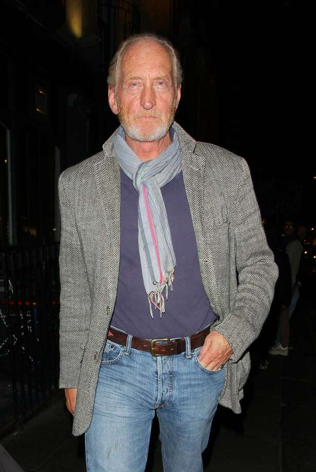 Charles Dance in a scarf, still looking like a tough guy, as he leaves the Groucho club in London on August 17, 2013. Photo: Mark Robert Milan, FilmMagic