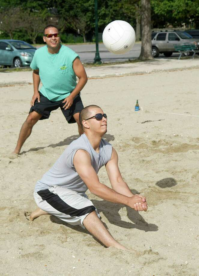 Carlos Solano, left, and Abner Valdes, right, play volleyball at Cummings Beach in Stamford, Conn., on Saturday, Sept. 14, 2013. Photo: Lindsay Perry / Stamford Advocate