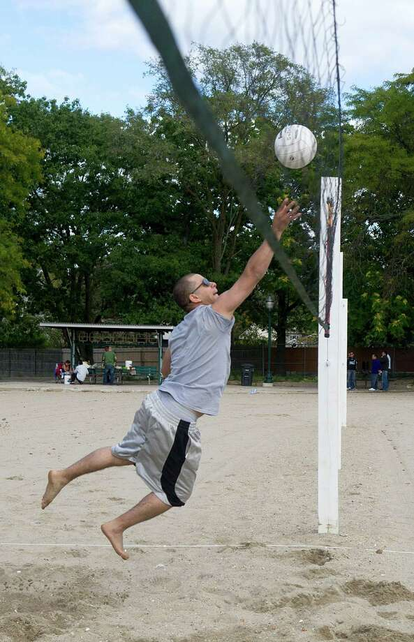 Abner Valdes plays volleyball at Cummings Beach in Stamford, Conn., on Saturday, Sept. 14, 2013. Photo: Lindsay Perry / Stamford Advocate