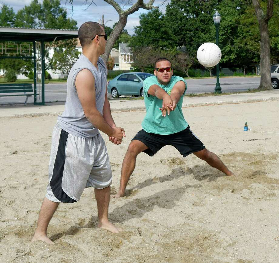 Abner Valdes, left, and Carlos Solano, right, play volleyball at Cummings Beach in Stamford, Conn., on Saturday, Sept. 14, 2013. Photo: Lindsay Perry / Stamford Advocate