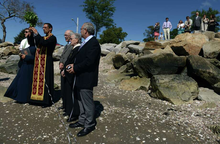 Holy Trinity Greek Orthodox Church in Bridgeport, Conn. conducts the traditional service of the Holy Cross on Saturday morning Sept. 14, 2013 at Seaside Park in Bridgeport, Conn. The ceremony celebrates the elevation of the Holy Cross and ends with the crucifix being tossed into the water for a parishioner to retrieve. Photo: Autumn Driscoll / Connecticut Post