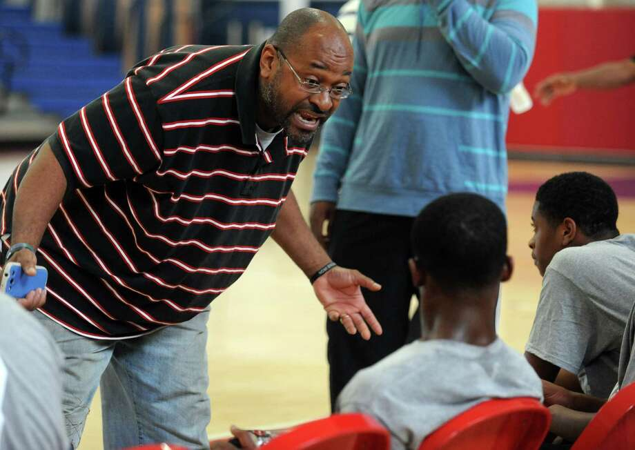 Norman Hall, of Bridgeport, coaches his team from New Vision International Ministries, during the first game of the Christian Basketball League Saturday Sept. 14, 2013 at the Cardinal Shehan Center in Bridgeport, Conn.  The league was organized by local churches to keep kids out of trouble and to help them meet other kids in a safe environment. Photo: Autumn Driscoll / Connecticut Post