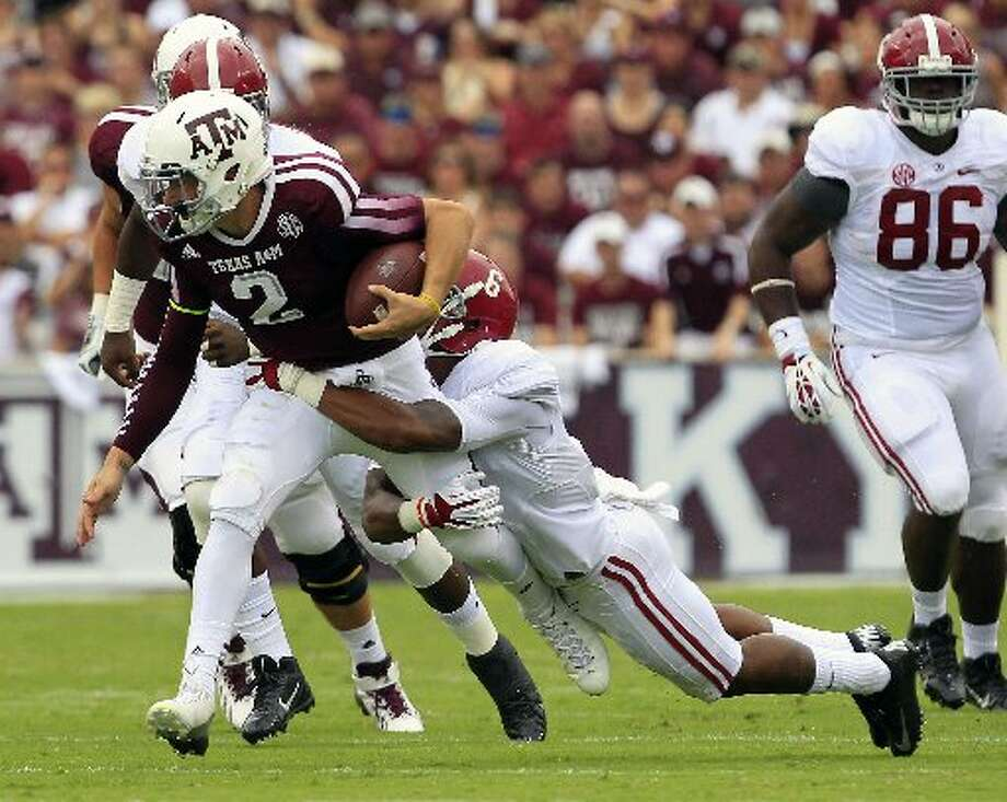 Texas A&M quarterback Johnny Manziel attemtps a scramble against Alabama. Photo: Cody Duty, Houston Chronicle