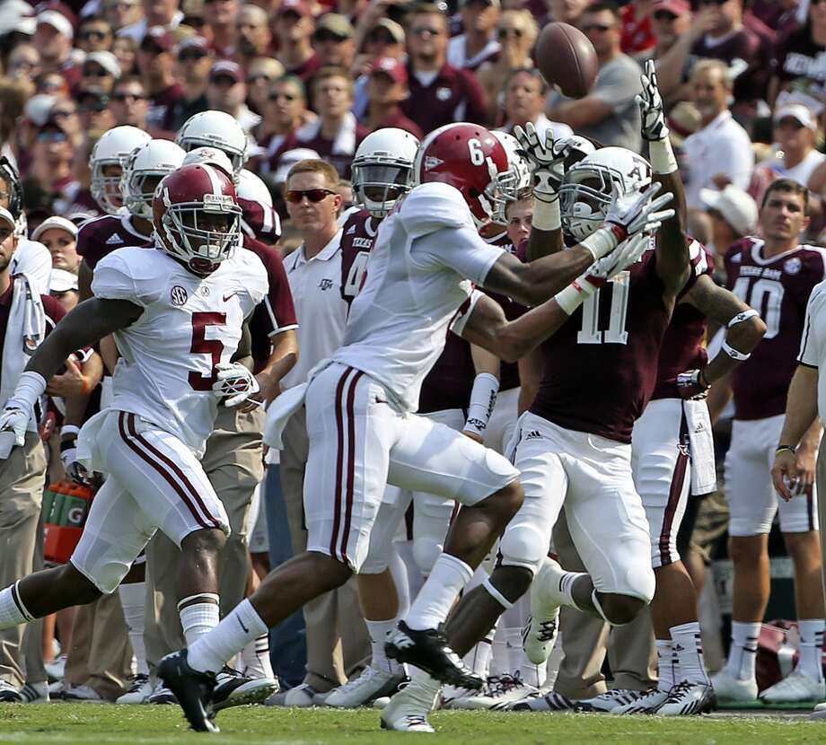 Aggie receiver Derel Walker can't pull down a long throw as defender Ha Ha Clinton-Dix contests as Texas A&M hosts Alabama at Kyle Field in College Station on September 14,  2013.