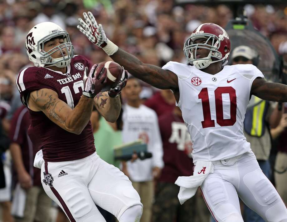 Aggie receiver Mike Evans pulls down a long catch against John Fulton to set up a first quarter touchdown as Texas A&M hosts Alabama at Kyle Field in College Station on September 14,  2013.