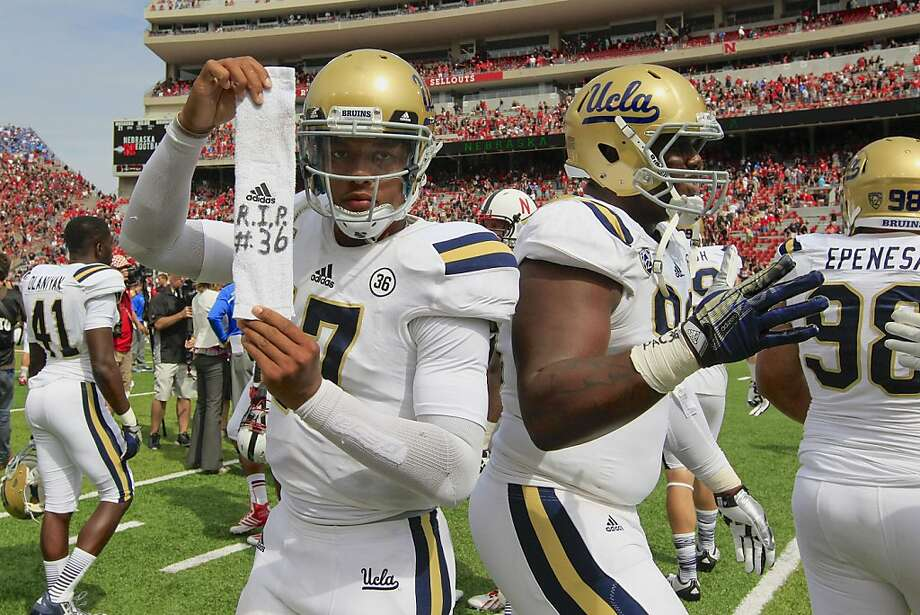 UCLA quarterback Brett Hundley (17) pays homage to teammate Nick Pasquale, who was killed last weekend. Pasquale wore No. 36. Photo: Nati Harnik, Associated Press