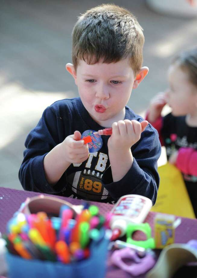 Max Hagan, 4, of Danbury, draws at Taste of Danbury at CityCenter Green in Danbury, Conn. on Saturday, Sept. 14, 2013.  The event featured many local food vendors and cooking demonstrations, along with various activities for families and children. Photo: Tyler Sizemore / The News-Times
