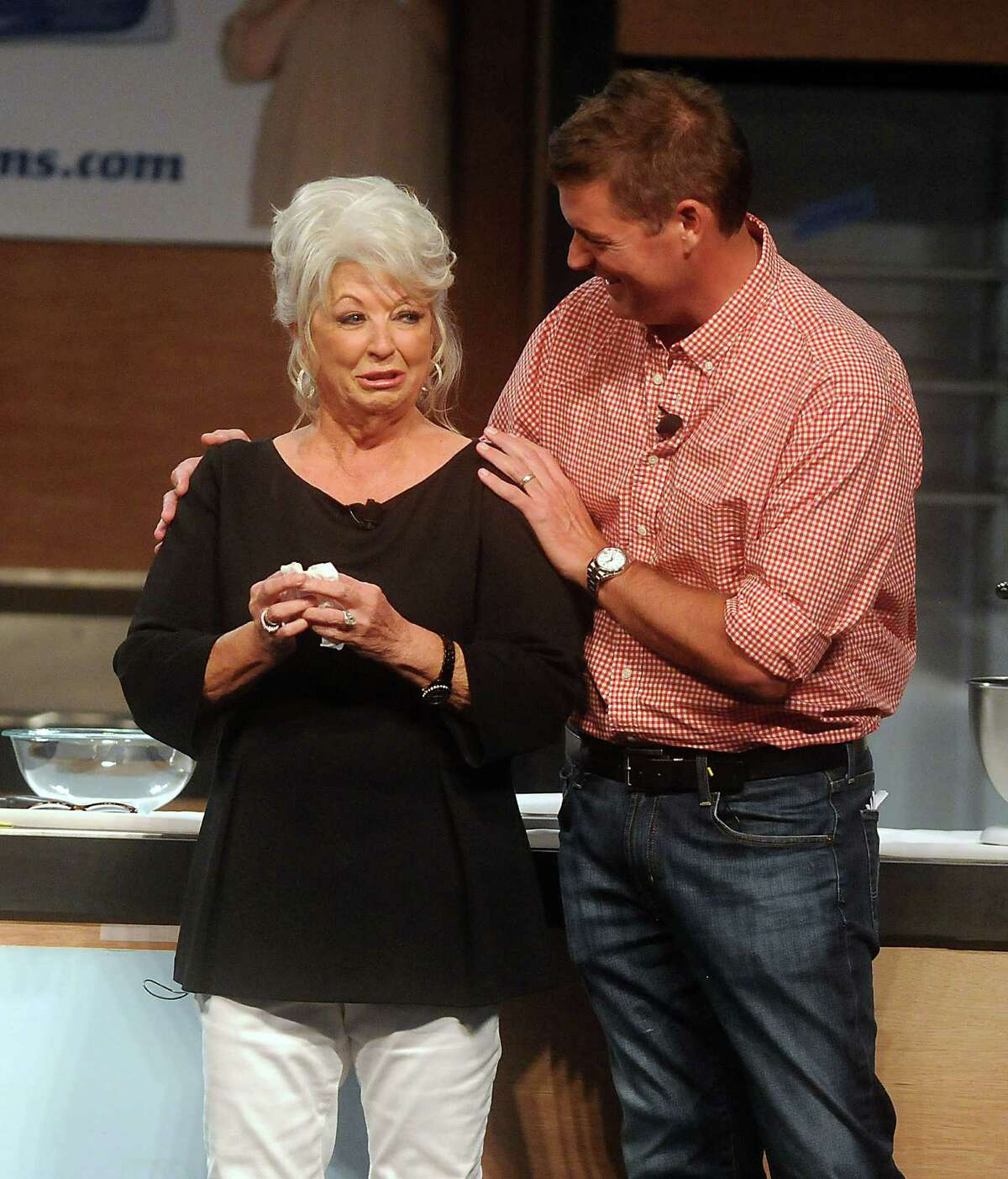 A tearful chef Paula Deen gets a hug from son Jamie as she is greeted by an ovation from the Houston crowd on Saturday.