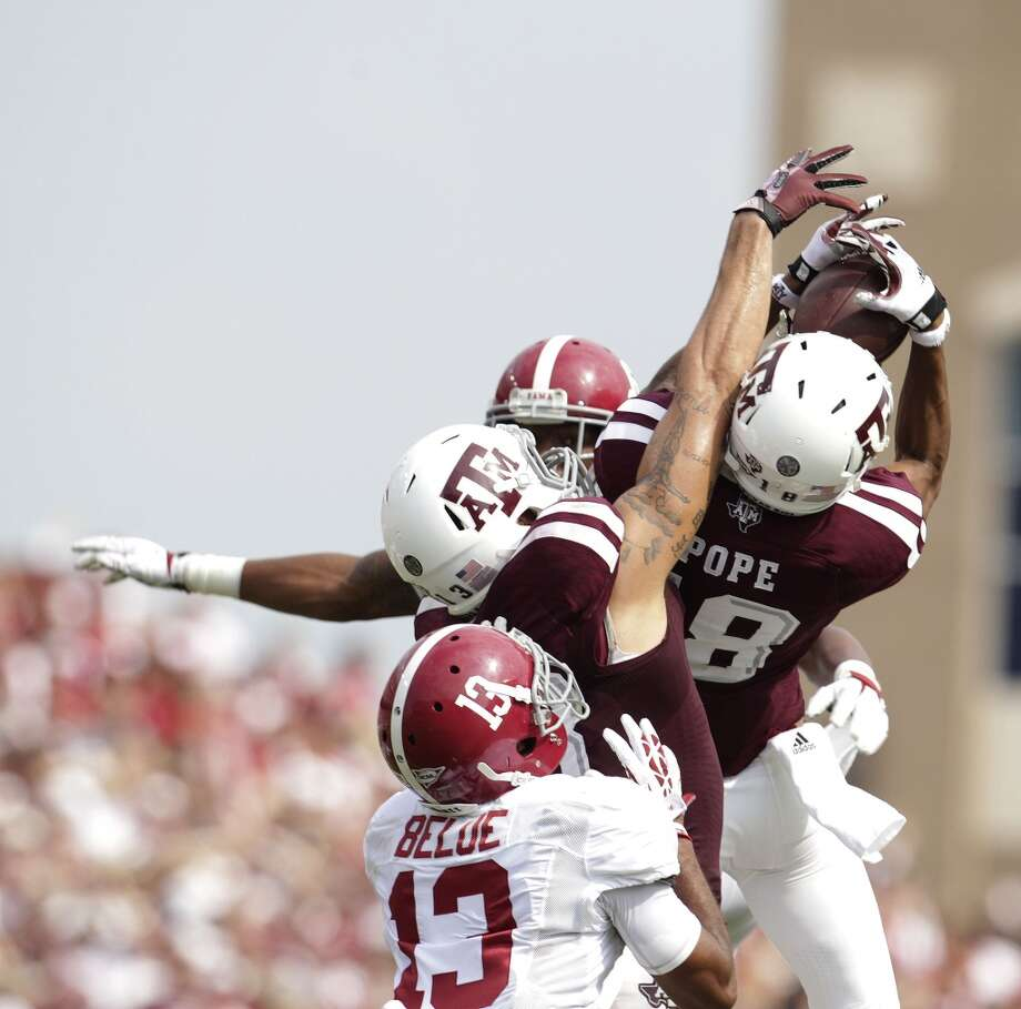 Alabama 49, Texas A&M 42Record: 2-1Edward Pope goes up for a catch between two Alabama defenders and a teammate. Photo: Karen Warren, Houston Chronicle