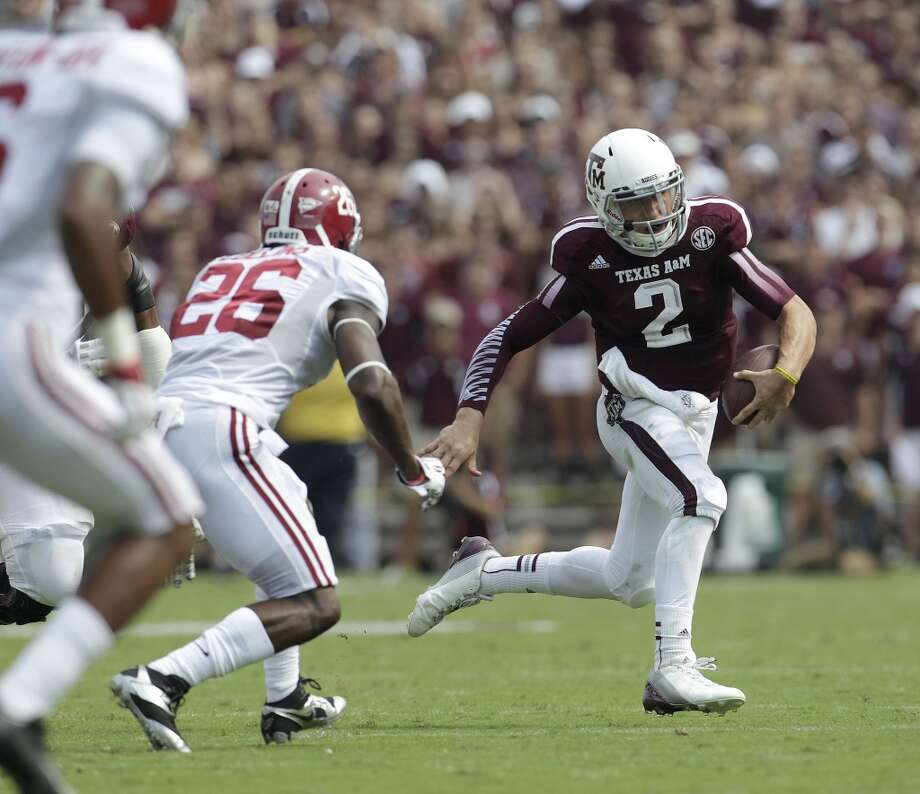Johnny Manziel runs around Alabama defender Landon Collins. Photo: Karen Warren, Houston Chronicle