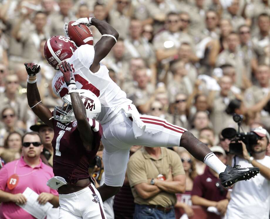 Alabama receiver Kevin Norwood comes down with a catch. Photo: Karen Warren, Houston Chronicle