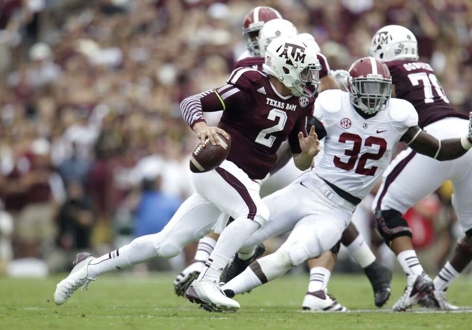 Johnny Manziel tries to escape an Alabama defender. Photo: Karen Warren, Houston Chronicle