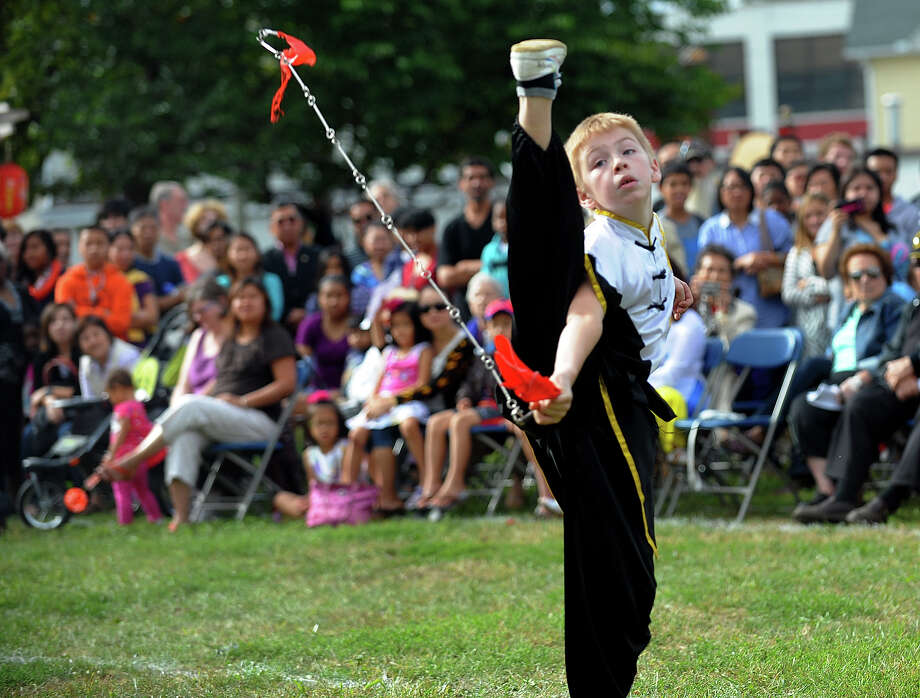 Justin LaBanca, 11, takes his turn performing martial arts, during the Little Asia 1st Annual Lunar Festival at Curiale School in Bridgeport, Conn. on Saturday September 14, 2013. LaBanca is with the Wu Dang Kung Fu Academy in Milford. Photo: Christian Abraham / Connecticut Post
