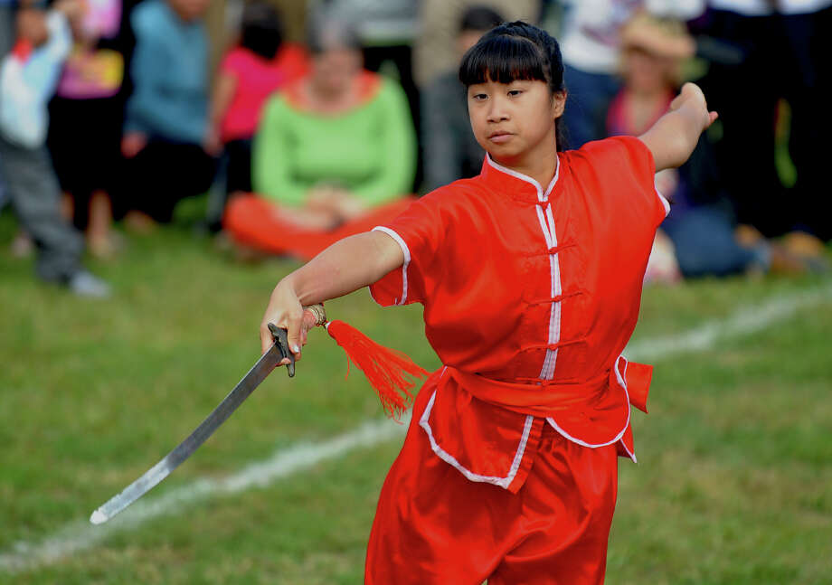 A member of the Wu Dang Kung Fu Academy in Milford, performs martial arts, during the Little Asia 1st Annual Lunar Festival at Curiale School in Bridgeport, Conn. on Saturday September 14, 2013. Photo: Christian Abraham / Connecticut Post