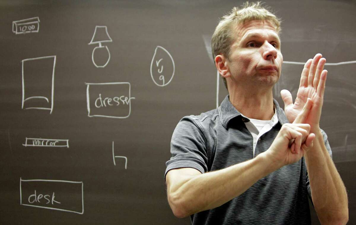 Scot A. Pott, a clinical assistant professor, teaching during his American Sign Language 3 class at the University of Houston Monday, Sept. 9, 2013, in Houston.