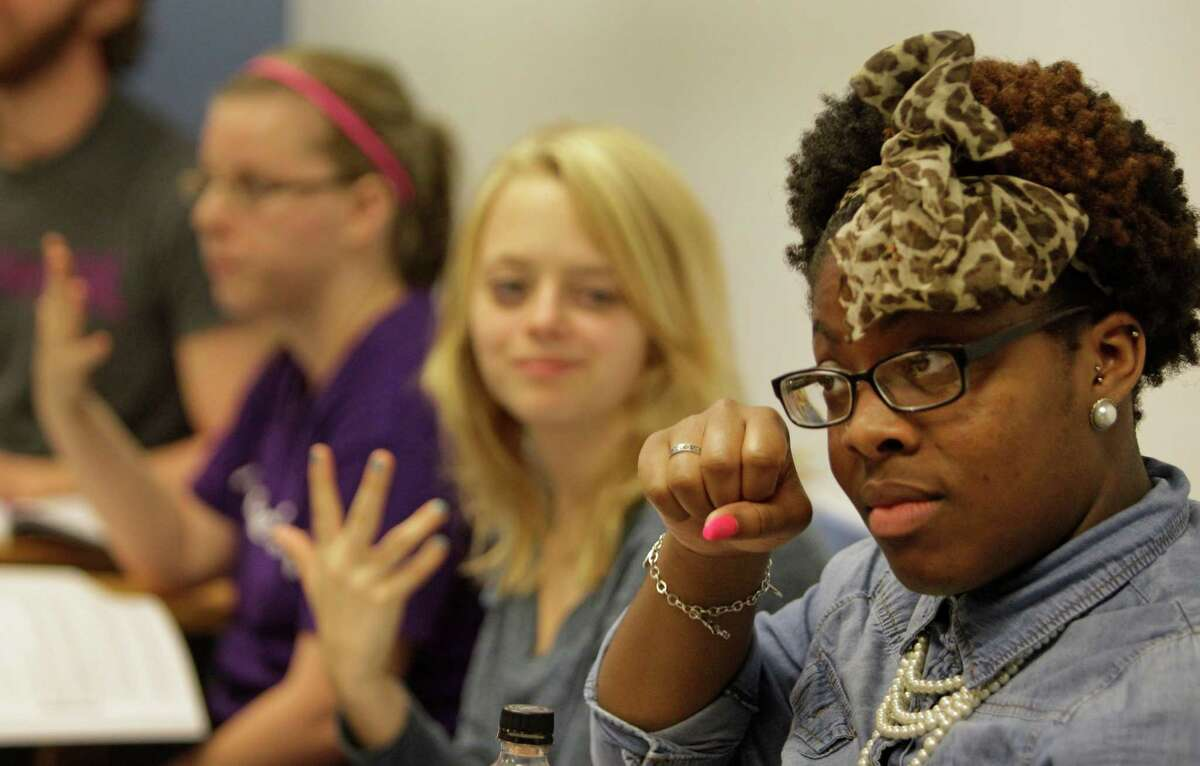 University of Houston student Lauren Kimble, right, of Houston, a sophomore, and others participate during their American Sign Language 3 class at the UH Monday, Sept. 9, 2013, in Houston.