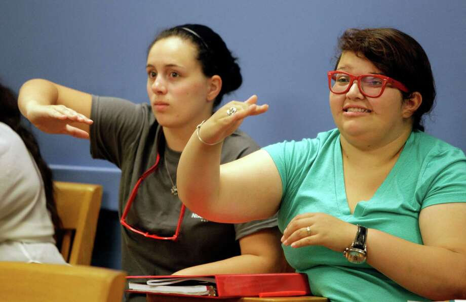 University of Houston students Sarah Rusinko, left, of Roanoke, a sophomore, and Andrea Segova, right, of San Antonio, a sophomore, participate during their American Sign Language 3 class at the UH Monday, Sept. 9, 2013, in Houston. Photo: Melissa Phillip, Houston Chronicle / © 2013  Houston Chronicle