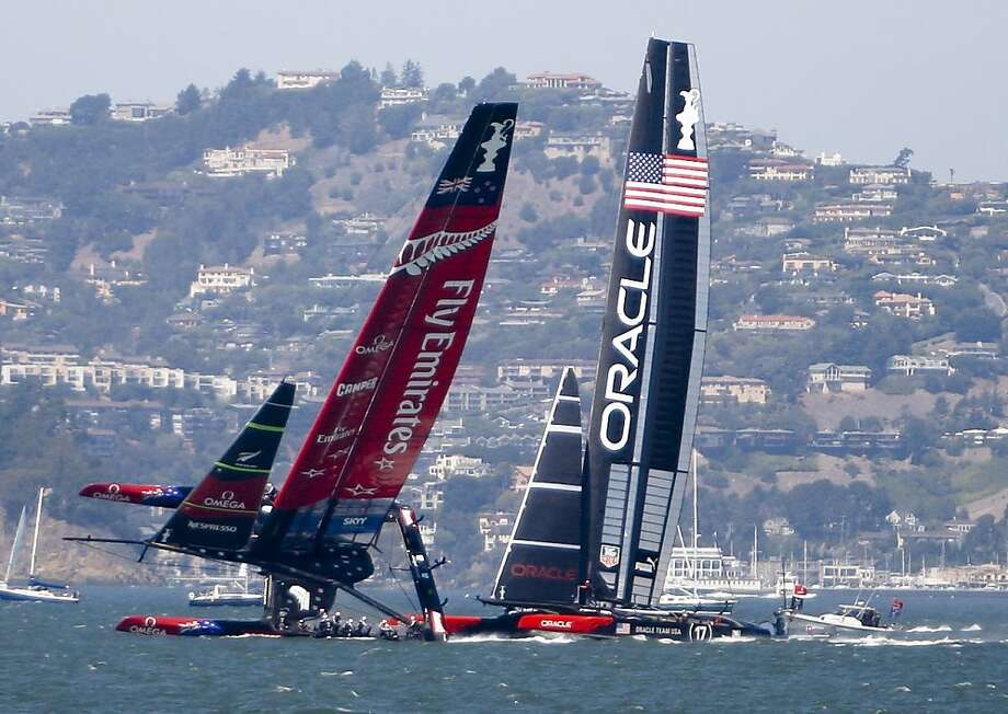 Team New Zealand works to right its boat after a near-capsizing. Oracle Team USA went on to win its second victory of the America's Cup finals with a 52-second margin over the Kiwis. Photo: Raphael Kluzniok, The Chronicle