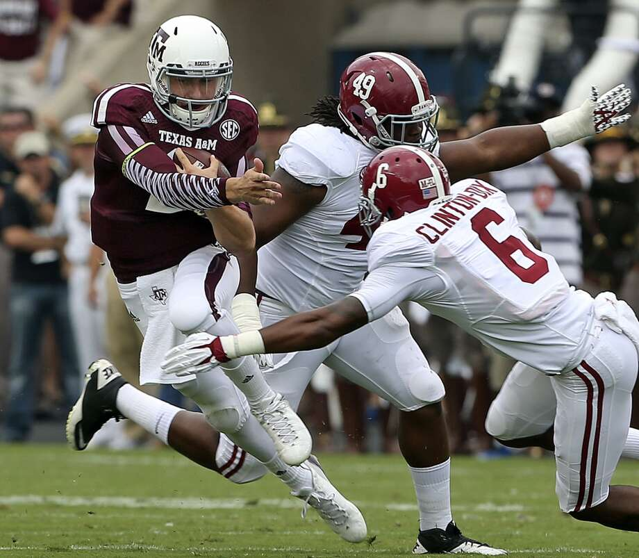 Aggie quarterback Johnny Manziel scrambles up the middle as  Texas A&M hosts Alabama at Kyle Field in College Station on September 14,  2013.