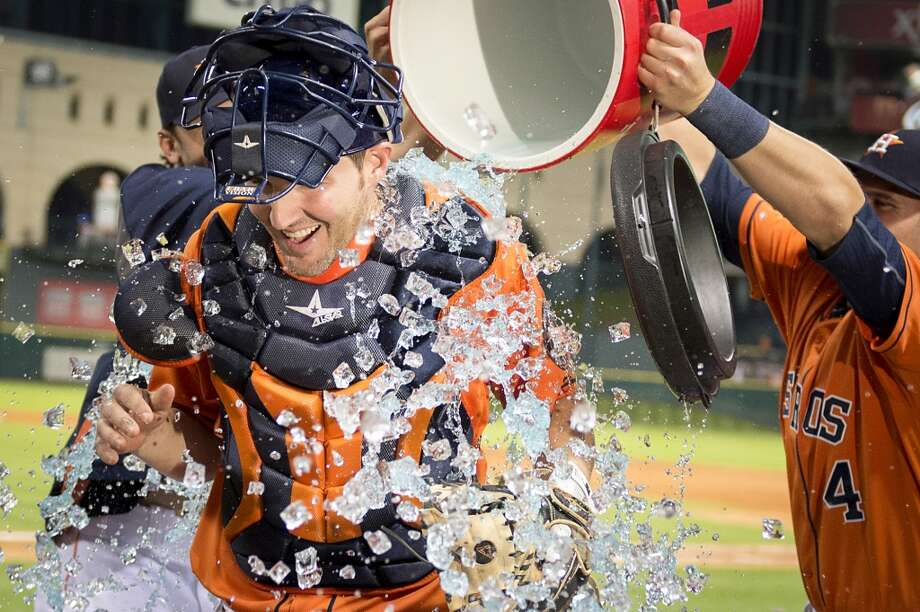 Sept. 13: Astros 9, Angels 7  Astros catcher Cody Clark gets a shower from his teammates after a victory over the Angels. Photo: Smiley N. Pool, Houston Chronicle