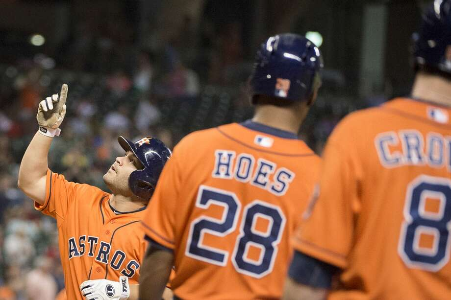 Astros second baseman Jose Altuve celebrates after hitting a three-run home run during the third inning. Photo: Smiley N. Pool, Houston Chronicle