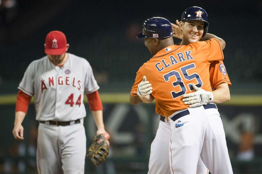 Astros catcher Cody Clark gets a hug from first base coach Dave Clark after collecting his first major league hit during the fifth inning. Photo: Smiley N. Pool, Houston Chronicle