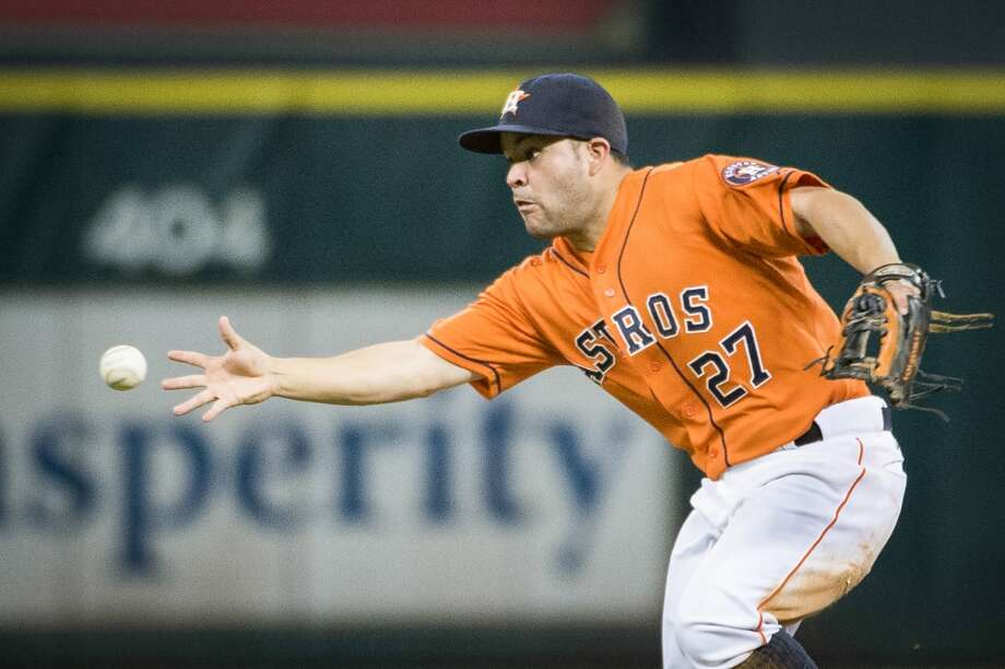 Astros second baseman Jose Altuve makes a barehanded play on a chopper off the bat of Angels third baseman Andrew Romine. Photo: Smiley N. Pool, Houston Chronicle