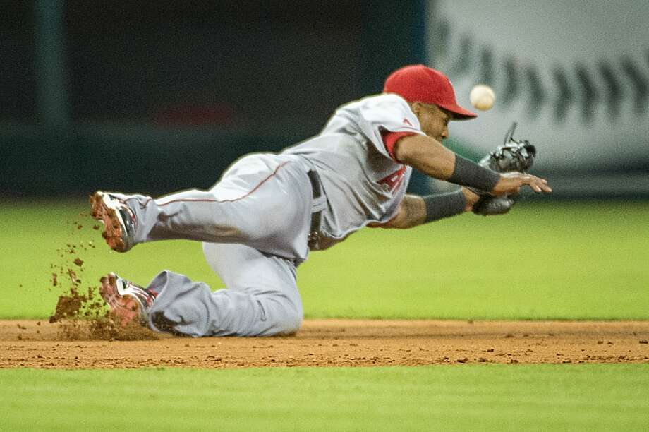 Angels shortstop Erick Aybar can't make the play on a bases-loaded single by Astros left fielder Trevor Crowe to drive in two runs. Photo: Smiley N. Pool, Houston Chronicle