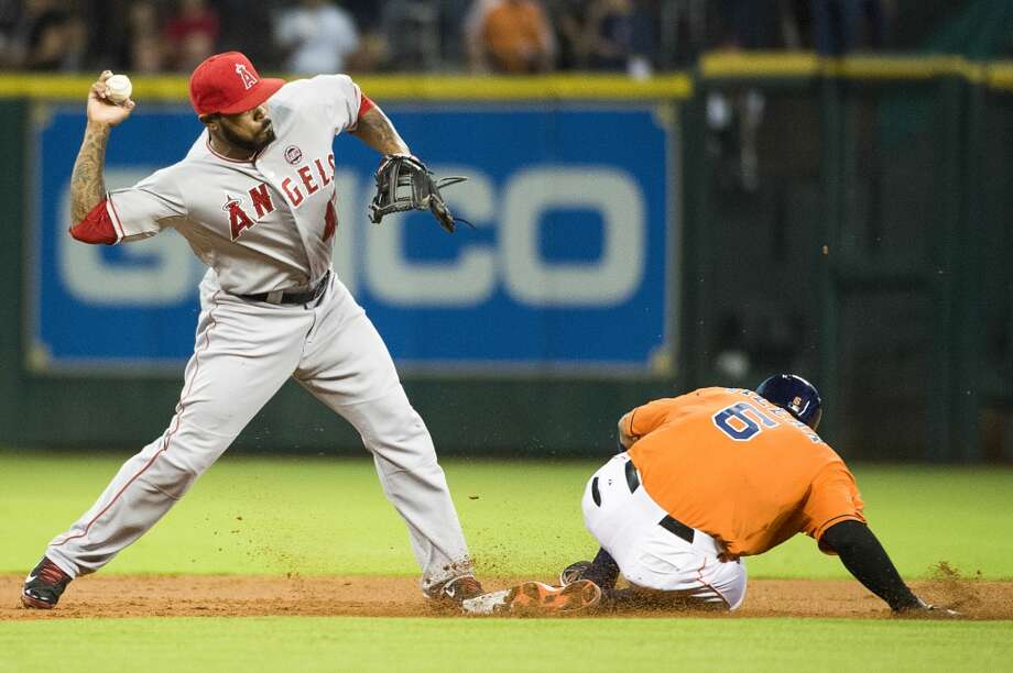 Angels second baseman Howie Kendrick can't make the relay trying to turn a double play as Jonathan Villar is out at second. Photo: Smiley N. Pool, Houston Chronicle