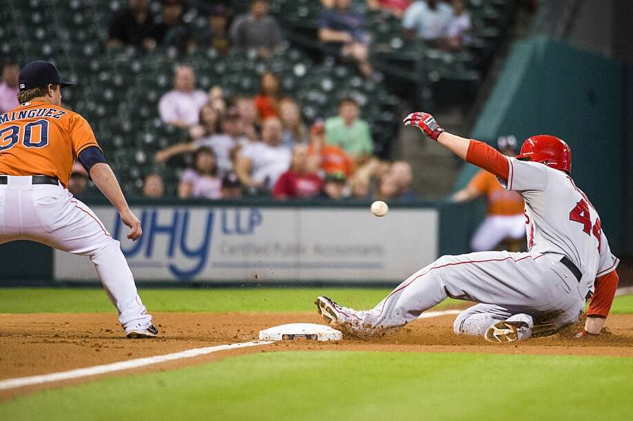 Angels first baseman Mark Trumbo is safe at third base with a triple to drive in two runs during the second inning. Photo: Smiley N. Pool, Houston Chronicle